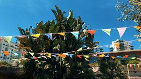 Festive flags hanging outdoors stock video footage