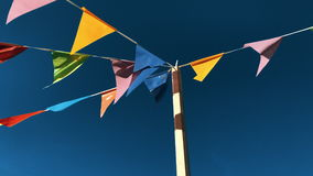 Festive flags hanging outdoors. Against blue sky. 4k footage stock footage