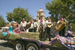Festive float with singing Mariachis makes its way down main street during a Fourth of July parade in Ojai, CA Royalty Free Stock Images