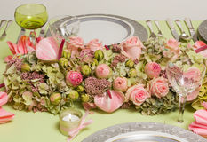 Festive flower arrangement on dinner table Stock Image