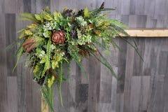 Festive flower arrangement on a gray wooden background. Artifici. Al flowers.copy space Stock Images