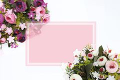 Festive flower composition with greeting card on the white background. Overhead view - Image royalty free stock photo