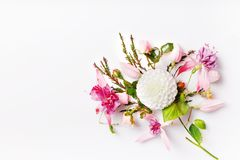 Festive flower composition on the white wooden background. Overhead view. Festive flower white dahlias, pink fuchsia composition on the white background stock photos