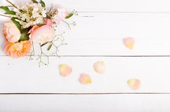 Festive flower composition on the white wooden background. Overhead view Royalty Free Stock Photography