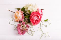 Festive flower composition on the white wooden background. Overhead view Royalty Free Stock Images
