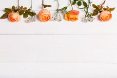 Festive flower composition on the white wooden background. Overhead view Royalty Free Stock Photo