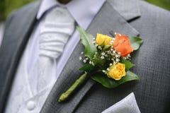Festive flower decoration for a groom Stock Photos