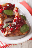 Festive food: baked duck leg with cranberry sauce and mint close Royalty Free Stock Photography
