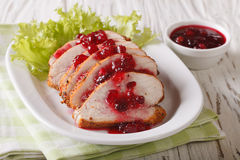 Festive food: roasted fillet of turkey with cranberry sauce on a Royalty Free Stock Image