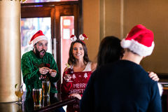 Festive friends in a bar Royalty Free Stock Photos