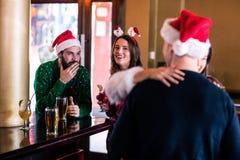 Festive friends in a bar Stock Photo