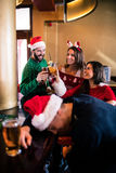 Festive friends drinking beer and cocktail Royalty Free Stock Photo