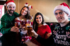 Festive friends drinking beer and cocktail Stock Photo
