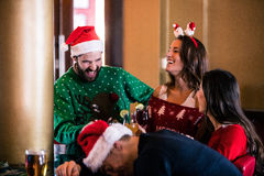 Festive friends drinking beer and cocktail Stock Photography