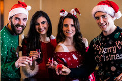 Festive friends having shots Royalty Free Stock Image