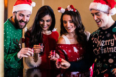Festive friends having shots. In a bar Stock Images