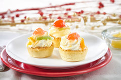 Festive fruit mini tarts Stock Images