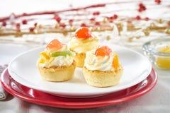 Festive fruit mini tarts Stock Images