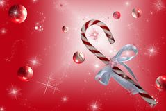Festive Fun. Traditional candy cane on sparkling background with bubbles Stock Photography