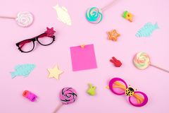 Festive funny celebration background with paper fish, sticky note and decor on pink background. All Fools ' Day, humor, prank, jok. E concept royalty free stock photos