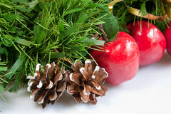 Festive Garland. A Christmas garland of leaves, apples & fir cones Royalty Free Stock Images