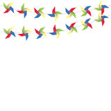 Festive garland of colored paper pinwheels. Horizontal festive garland of pinwheels. Bright garland for decoration. Stock Photos