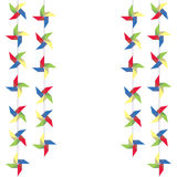 Festive garland of colored paper pinwheels. Vertical festive garland of pinwheels. Bright garland for decoration. Stock Images