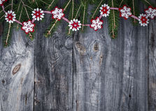 Festive garland of fir branches and decorative felt snowflakes Stock Image