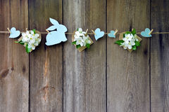 Festive garland. Rabbits and apple blossoms. Background. Spring. Royalty Free Stock Images