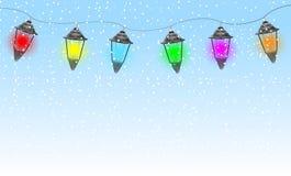 Festive garland with varicoloured lanterns Stock Photo