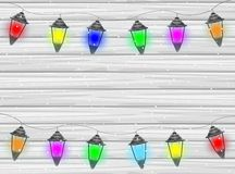 Festive garland with varicoloured lanterns on a wooden backgroun. D,  vector  illustration Royalty Free Stock Photography