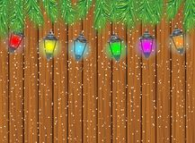 Festive garland with varicoloured lanterns on a wooden backgroun Royalty Free Stock Images