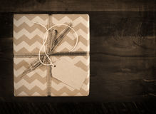 Festive gift box with chevron stripes in sepia tones Stock Photography