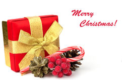 Festive gift box with decorations on white Stock Image