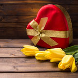 Festive gift box and flowers Royalty Free Stock Image
