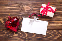 Festive gift box with present  and empty tag on aged  wooden bac Stock Photos