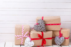 Festive gift boxes and  grey and white decorative hearts Royalty Free Stock Photos