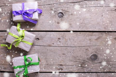 Festive gift boxes with presents on vintage wooden background. Royalty Free Stock Photography