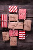 Festive gift boxes with presents   on vintage wooden background. Royalty Free Stock Photo