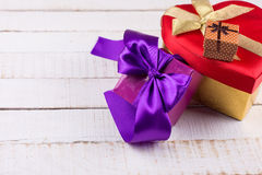 Festive gift boxes on white wooden background Stock Photography