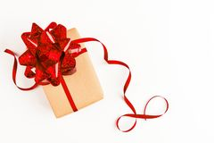 Festive gift with red bow on white background. Overhead view Royalty Free Stock Photography