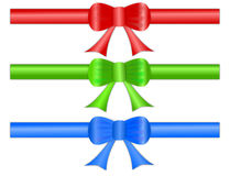 Festive Gift Ribbon Bows. A set of three festive gift ribbon bows in shiny satin like material, for page headers and footers Royalty Free Stock Images