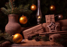 Festive Gifts with Boxes, Coniferous, Basket, Pine Cones on Wooden Background. Vintage Style Royalty Free Stock Photos