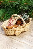 Festive Gifts with boxes, star anice, basket, cinnamon and snowflake on Wooden Background. Christmas Presents with copy space royalty free stock photos