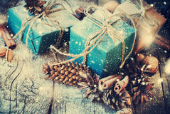 Festive Gifts Decorated with Linen Cord, Pine cones, Nuts. Snow Drawn Royalty Free Stock Photography