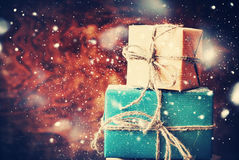 Festive Gifts on Wooden Background. Snow Drawn Stock Images