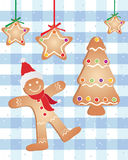Festive gingerbread. An illustration of seasonal festive gingerbread santa christmas tree and decorated stars on a snowy tablecloth background Royalty Free Stock Images
