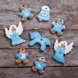 Festive gingerbread cookies on wooden table Royalty Free Stock Photos