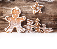 Festive gingerbread on wooden background Royalty Free Stock Photo