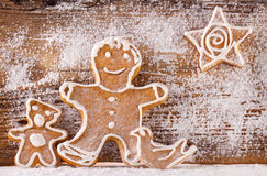 Festive gingerbread on wooden background Royalty Free Stock Images